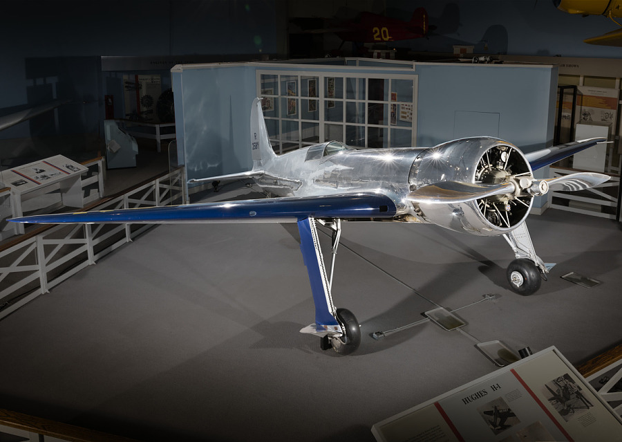 Metalic silver and blue Hughes H-1 Racer aircraft in museum