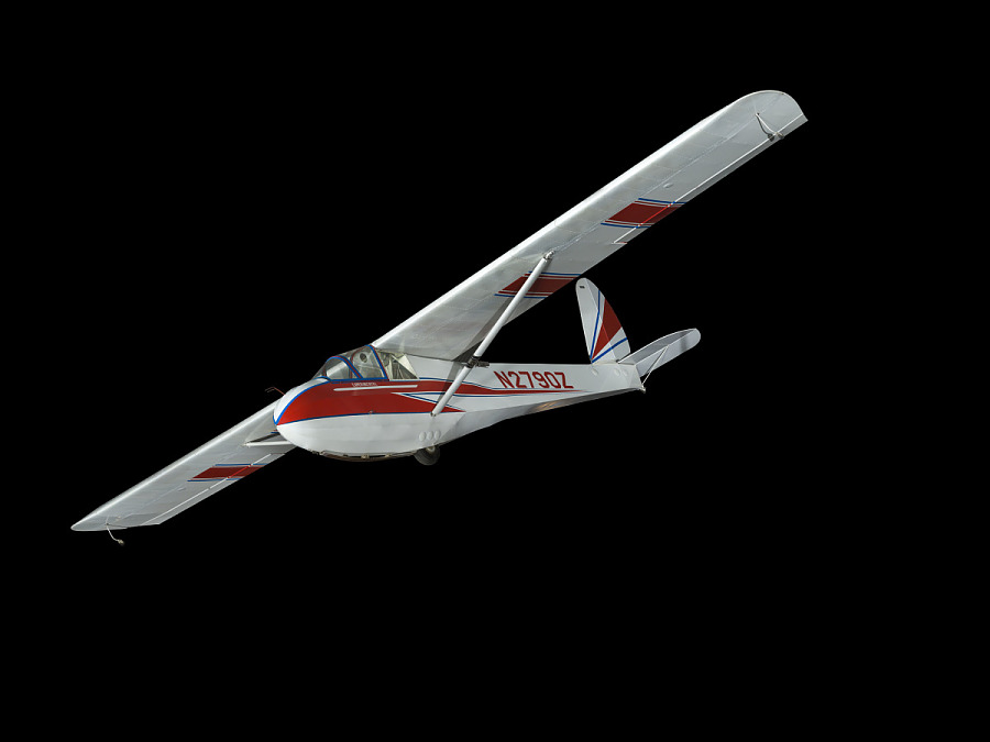 White and red sailplane with blue trim, against black background