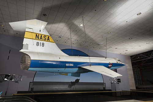 Overall, side view of Lockheed F-104A Starfighter jet hanging in museum