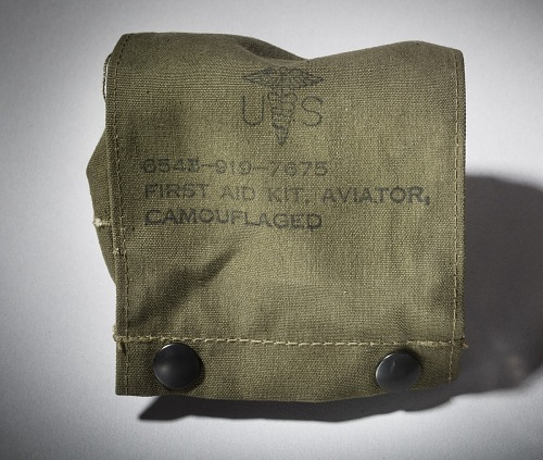 """Olive-green canvas, snap button pouch with inscription on flap, """"FIRST AID KIT, AVIATOR,                 CAMOUFLAGED"""""""
