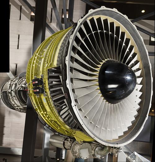 Circular Turbofan Engine with yellow-green housing in museum