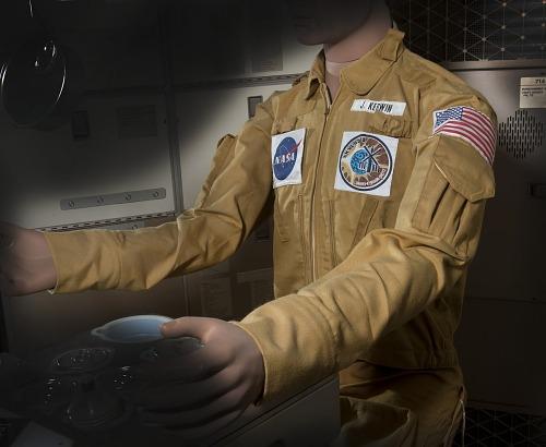 Joe Kerwin's tan woven durette Skylab 2 Jacket on mannequin with outstretched arms in Skylab                 Orbital Workshop