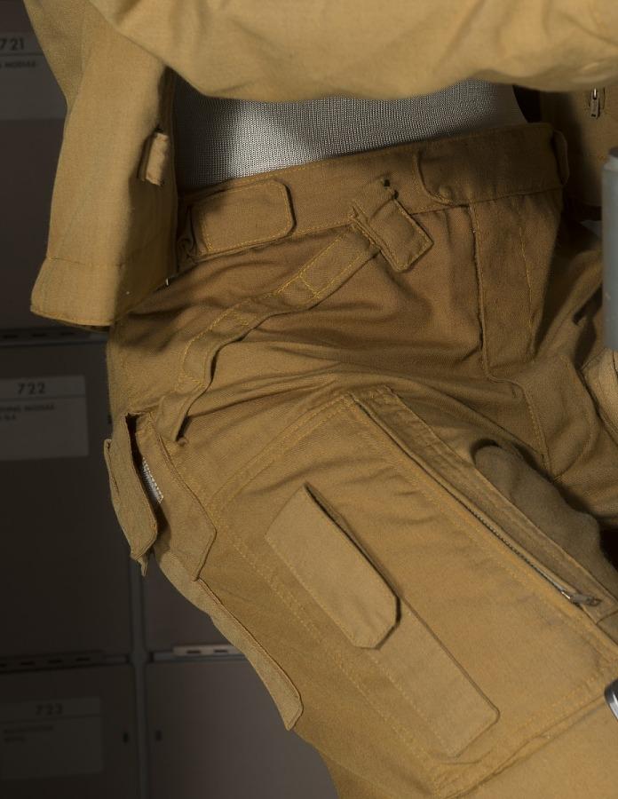 Waist of Joe Kerwin's Skylab 2 tan woven durette trousers on of mannequin