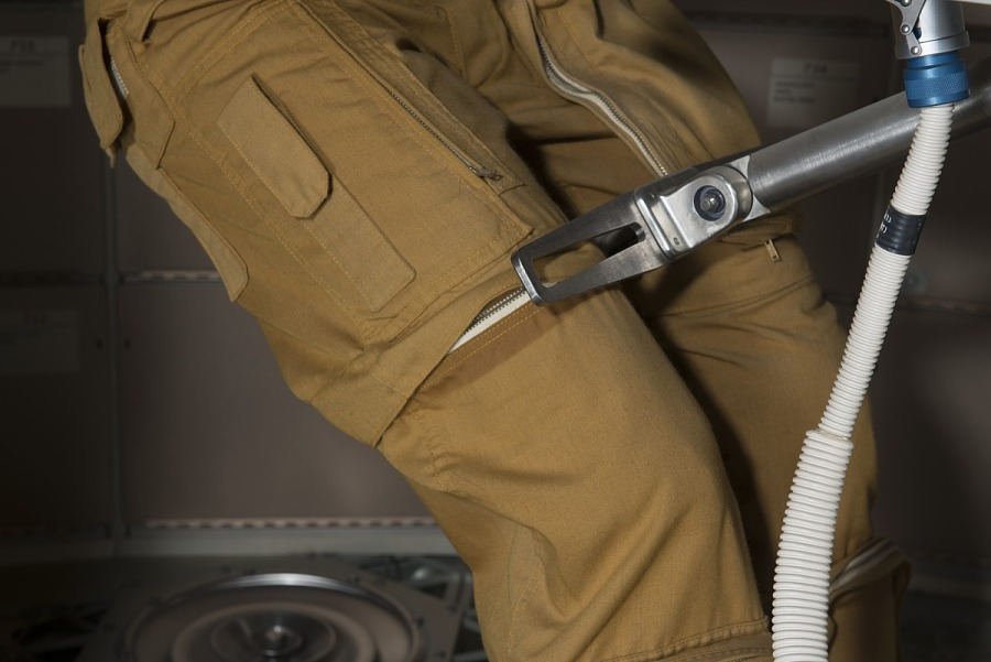 Joe Kerwin's Skylab 2 tan woven durette trousers with hidden zippers and pockets on upper legs                 of mannequin