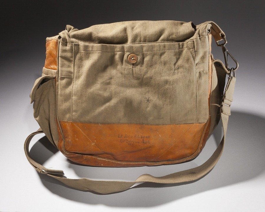 Front of leather and canvas bag with detachable strap