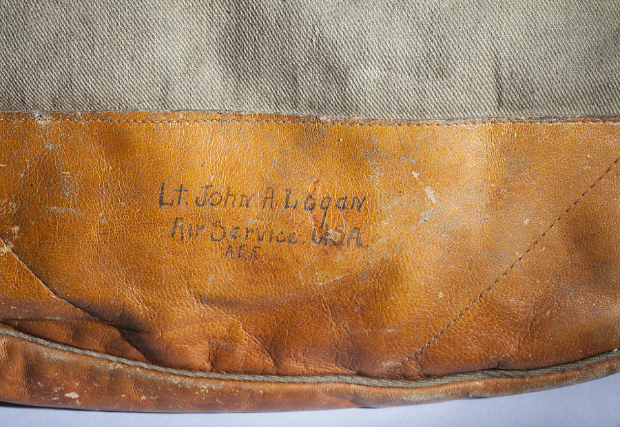 Closeup view of engraving on leather, 'Lt. John A. Logan - Air Service USA - A. E. F.'