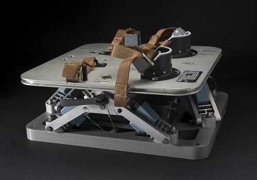 Side of Skylab Force Measuring Unit metal platform with foot restraints and brown straps