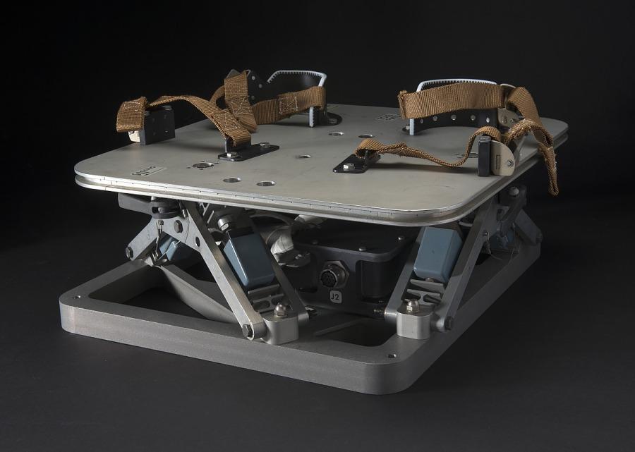 Front of Skylab Force Measuring Unit metal platform with foot restraints and brown straps