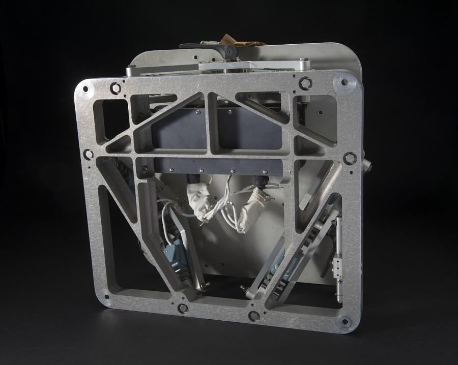 Bottom of Skylab Force Measuring Unit square shaped metal platform with white wiring