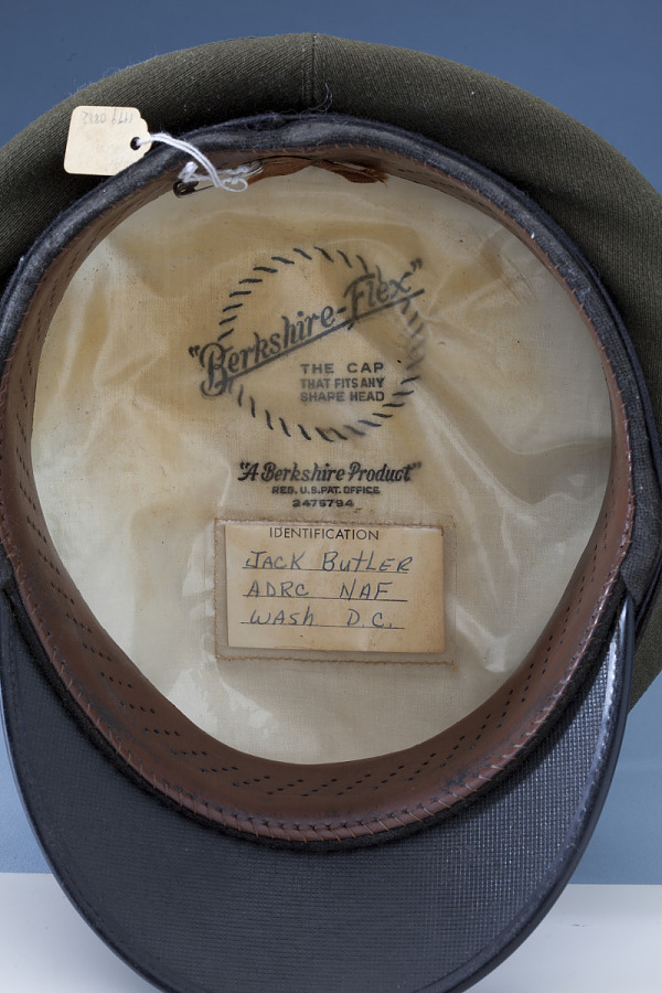 Inside of United States Navy Service Cap with hand-written ID card for 'Jack Butler'