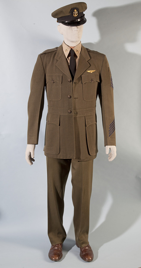 Full olive-green United States Navy Summer Service suit ensemble with buttoned jacket on mannequin model