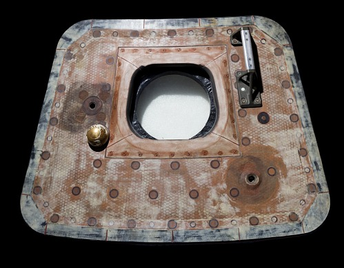Trapezoid shaped metal Apollo 11 Crew Hatch door with handle