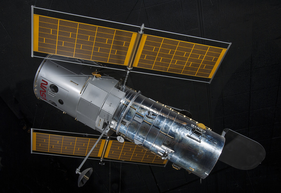 Side view of metal Hubble Space Telescope Model with yellow solar panels