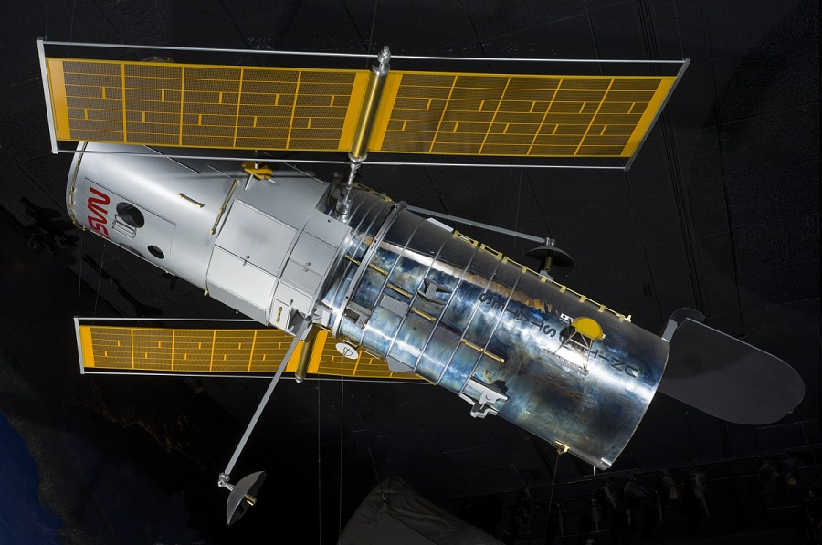 Side view of metal Hubble Space Telescope Model hanging in museum