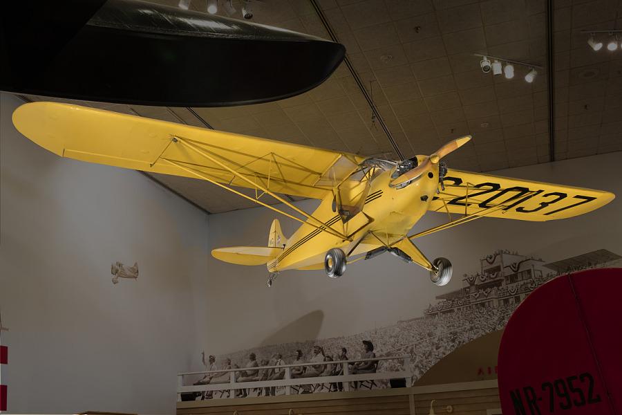 Yellow Piper J-2 Cub hanging in museum