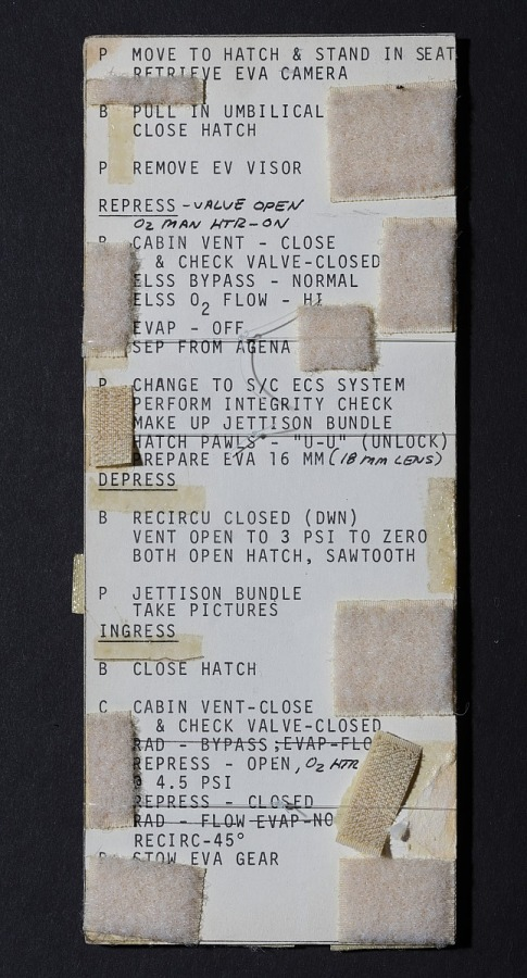 Back of long vertical Gemini 10 Umbilical EVA Checklist Card with small velcrow pieces covering                 words