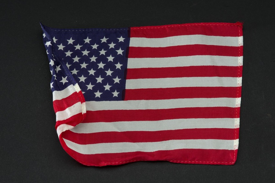 Apollo 11 United States of America cloth Flag folded on left side