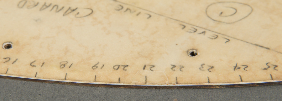 Curved groove of plastic wing-shaped Canard Template with pencil markings