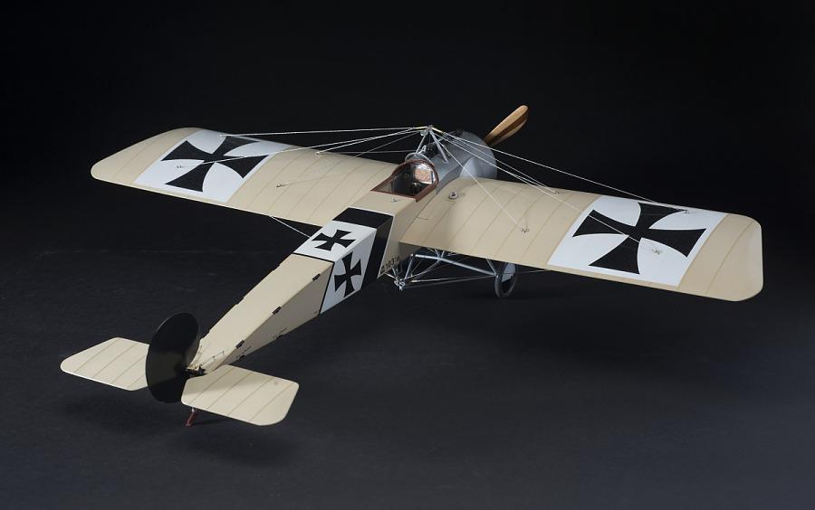 Rear view of tan, plastic exhibit model of an Imperial German Air Service Fokker E.III Eindekker                 aircraft