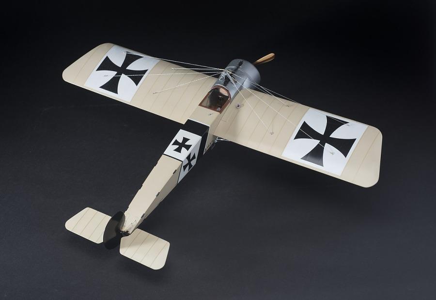 Top view of tan, plastic exhibit model of an Imperial German Air Service Fokker E.III Eindekker                 aircraft