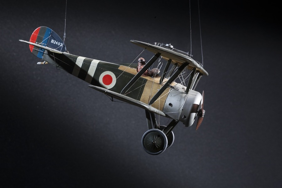 Side of green and tan, plastic exhibit model of a British Royal Air Force Sopwith F.1/3 Camel                 'Comic' Night Fighter aircraft