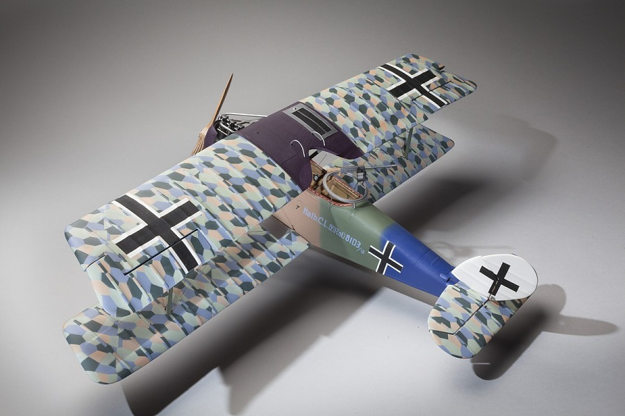 Rear, top view of plastic exhibit model of an Imperial German Air Service Halberstadt CL.IV                 ground attack aircraft in camouflage color scheme