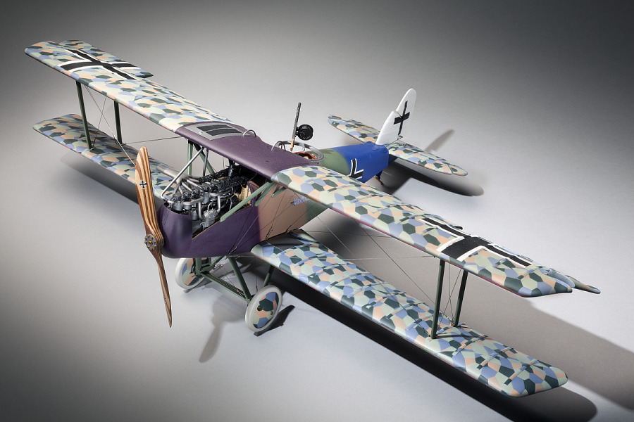 Three quarter view of plastic exhibit model of an Imperial German Air Service Halberstadt CL.IV                 ground attack aircraft in camouflage color scheme