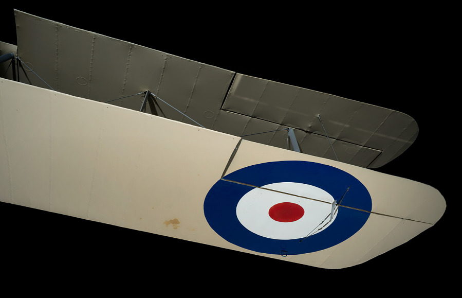 Circular Biritsh insignia under of wing with Sopwith 7F.1 Snipe hanging in gallery