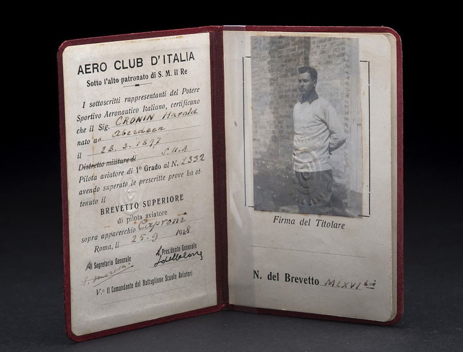 Italian pilot's license with signature and full-length ID photo, affixed to leather case
