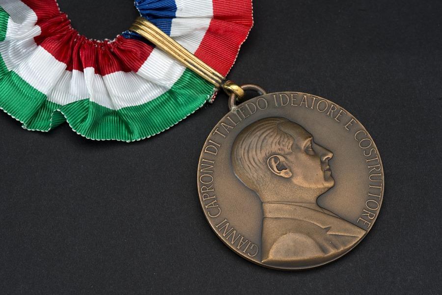 Closeup of bronze commemorative medal with portrait of Count Caproni