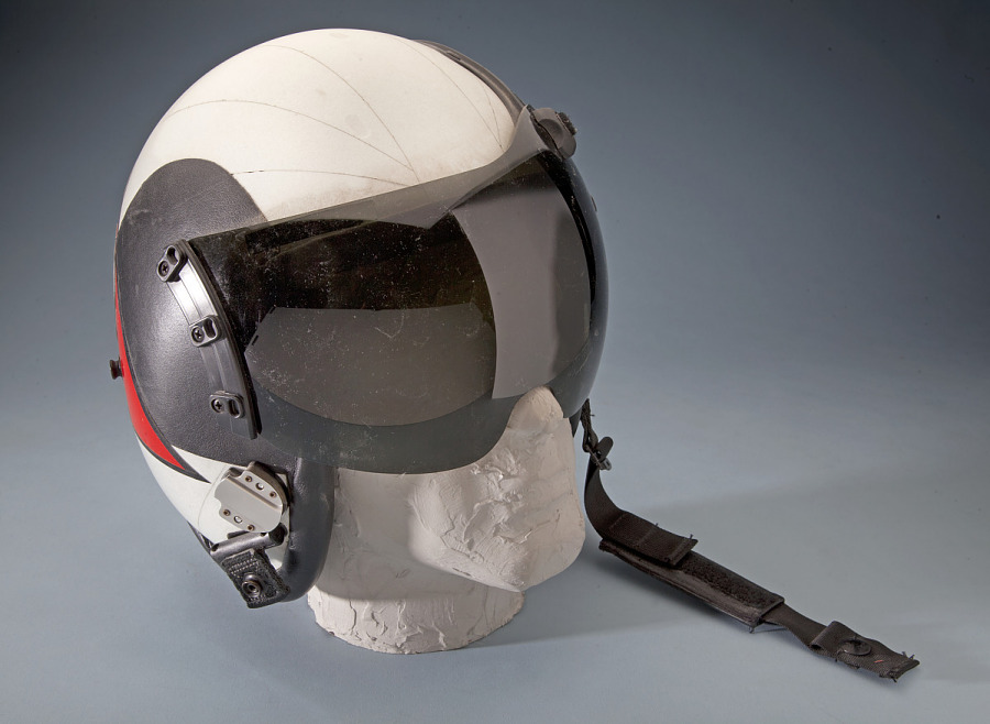 Front of United States Navy Helmet with black tinted visor on mannequin head
