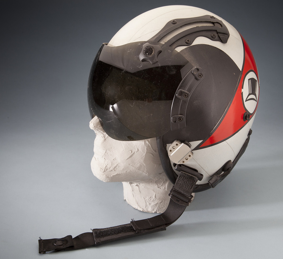 Side and back of white and red United States Navy Helmet on mannequin head