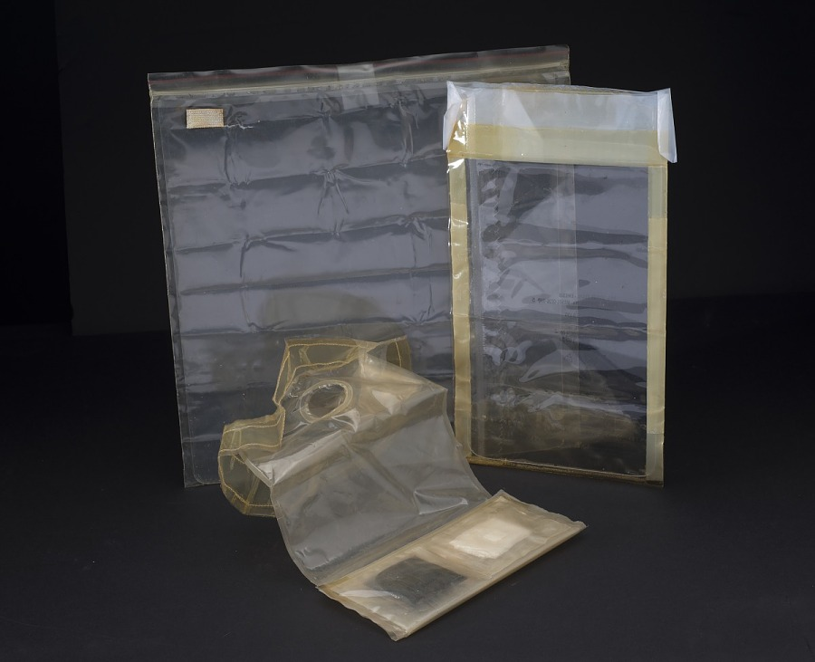 Three clear plastic Apollo 11 Fecal Collection Assembly bags