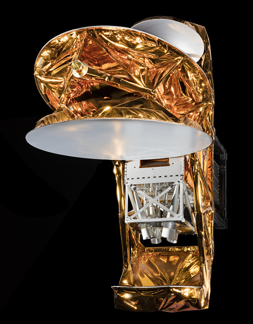 Full-scale model of Wilkinson Microwave Anisotropy Probe, made up of a rectangular white box, dish-shaped reflectors, and gold mylar