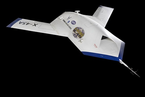 Three quarter side view of flat spear-shaped white and blue Boeing X-45A aircraft