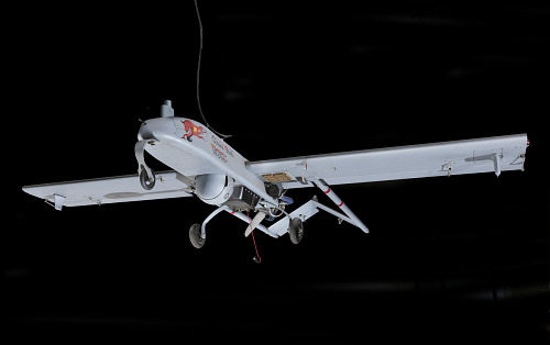 """Three quarter front view of RQ-7A Shadow 200 aircraft, """"Screamin' Demon"""", hanging in gallery"""