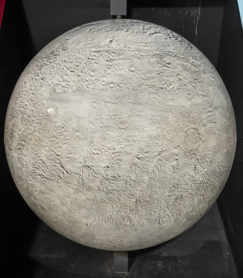 Orb with images of craters and mountains, shown on display