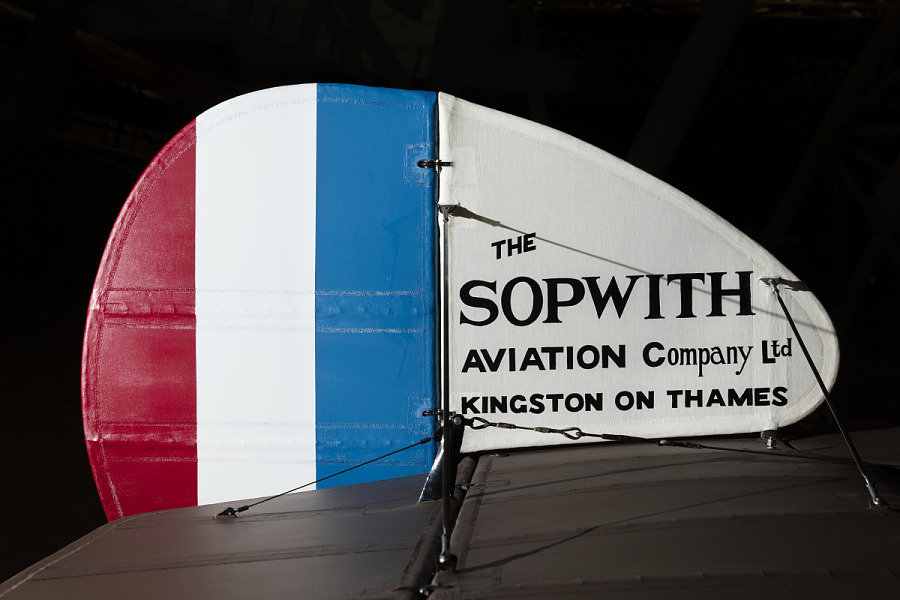 Rounded red, blue, and white painted metal camel tail of Sopwith F.1 aircraft