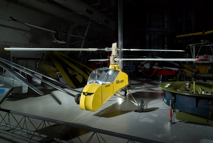 Yellow painted helicopter with two main rotor blades.