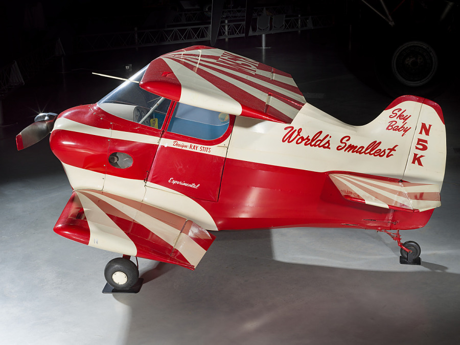 Red and white painted smallest man-carrying plane.