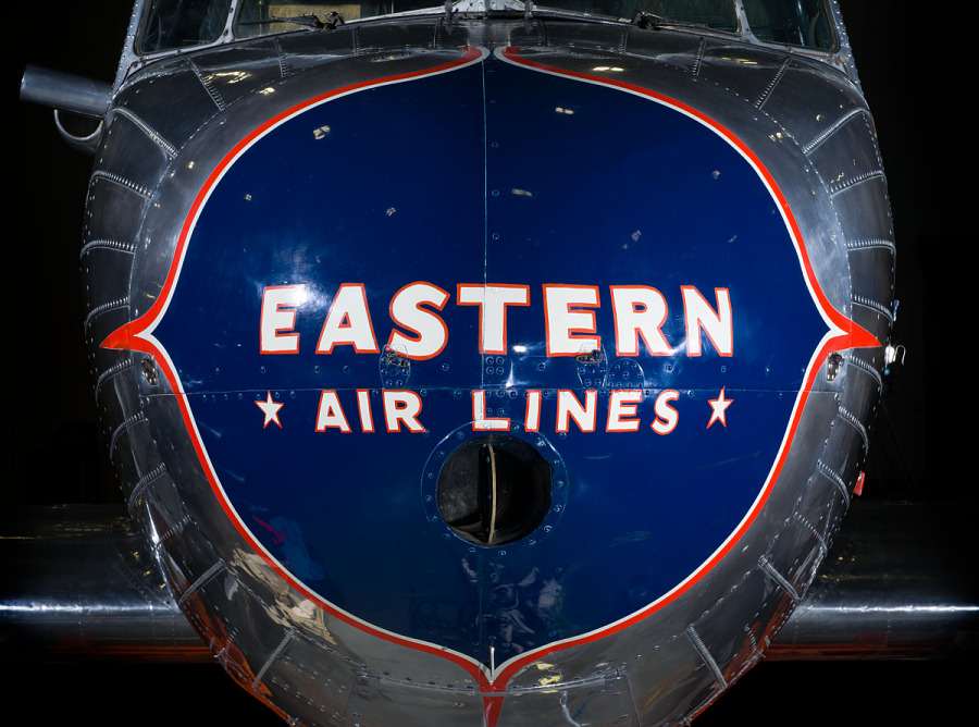 """Close up of the nose of the plane. Painted on a blue nose is the phrase """"Eastern *Air Lines."""""""