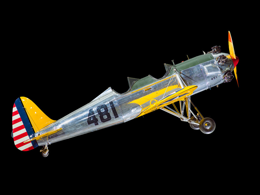 Side view of a silver and yellow plane.