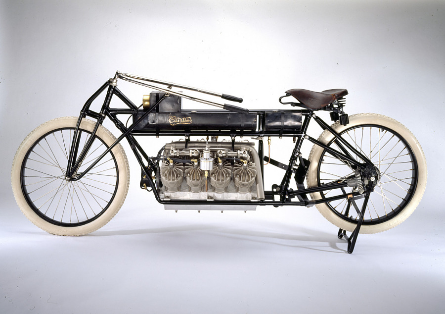 Black metal framed motorcycle with exposed engine and white tires