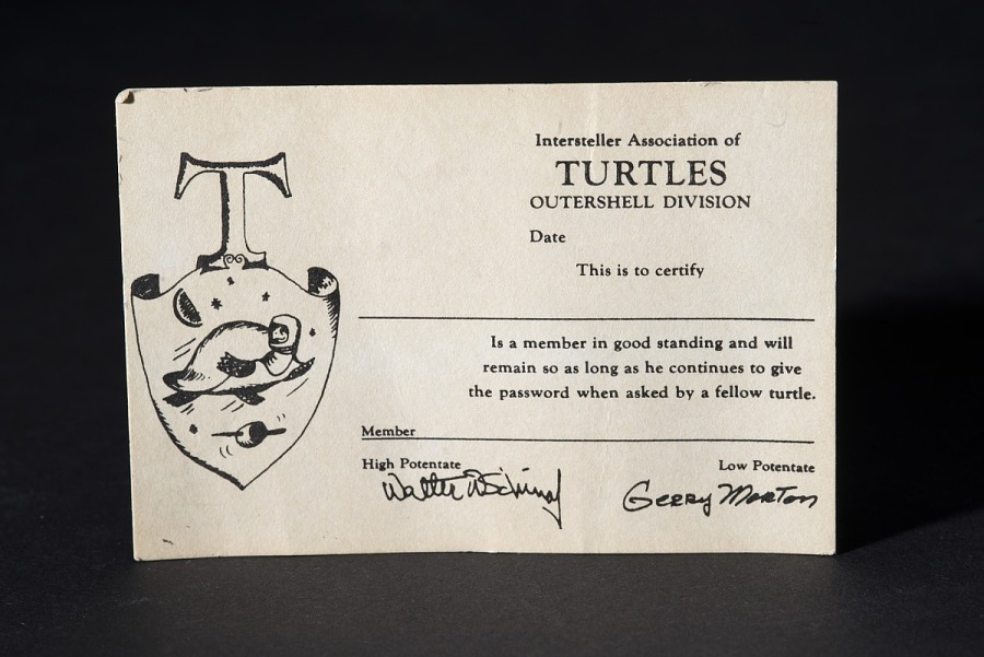 Paper membership card for 'Interstellar Association of Turtles' with illustration of turtle on crest