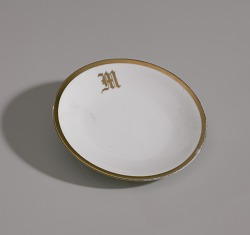 White plate with gold trim from Mae's Millinery Shop