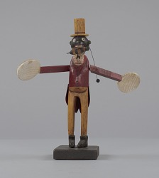 Whirligig in the form of a caricatured man swatting a bee