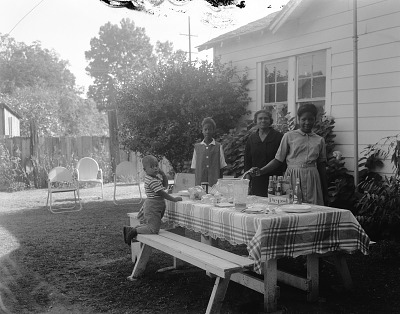 Outdoor Portrait of a Family Standing by a Picnic Table