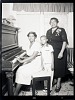 thumbnail for Image 2 - Indoor Portrait of Two Women and a Boy Standing at the Piano