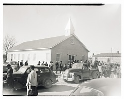Outdoor Photo of a of Men and Women Leaving Church