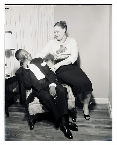 Image for Indoor Portrait of a Man and Woman Sitting and Looking, Doctors and Wives